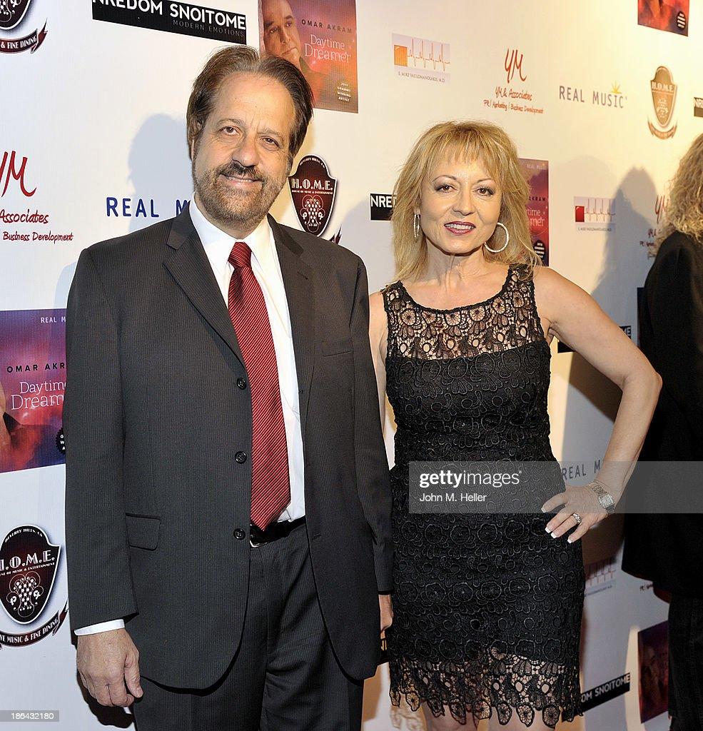 E. Mike Vasilomanolakis M.D, and Niki Vasilomanolakis attend the 2013 Grammy Award Winner Omar Akram's album release party for 'Daytime Dreamer' at the House of Music & Entertainment on October 30, 2013 in Beverly Hills, California.