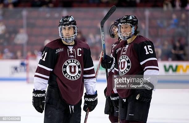 Mike Vecchione of the Union College Dutchmen talks to teammate Spencer Foo during a game against the Boston University Terriers during NCAA hockey at...
