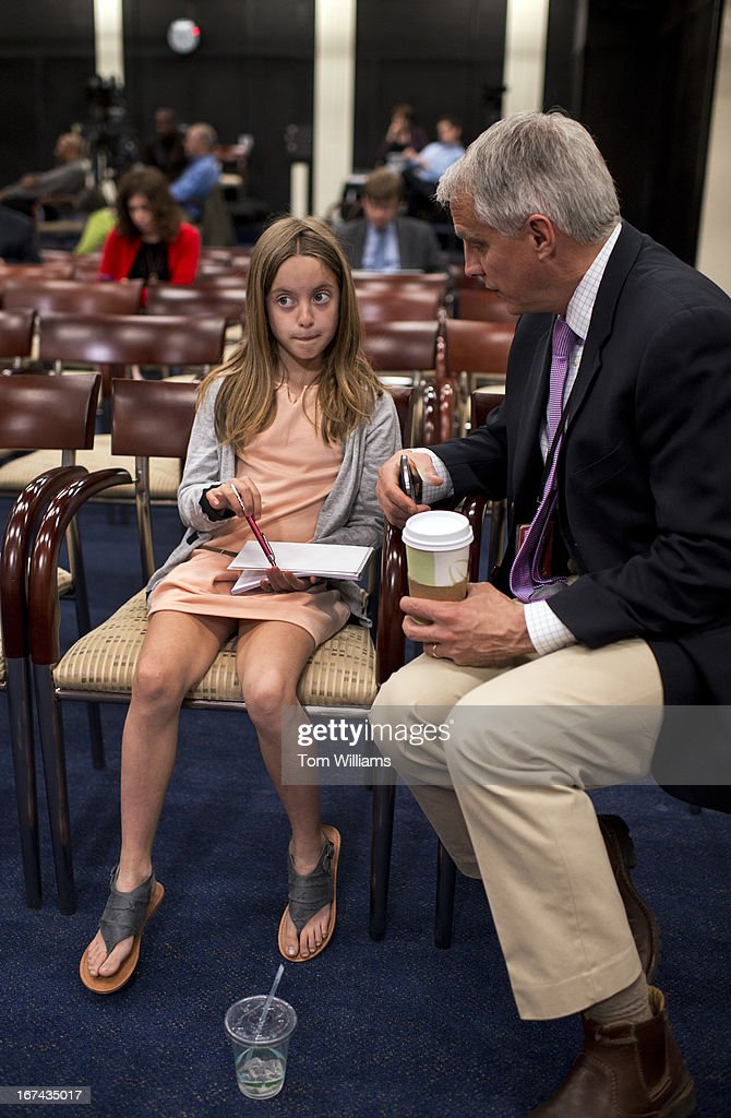 Mike Viqueira of NBC News, and his daughter Ava, 10, prepare for news conference in the Capitol Visitor Center with House Minority Leader Nancy Pelosi, D-Calif. Many children were on the Hill for 'Take Our Daughters and Sons to Work Day.'
