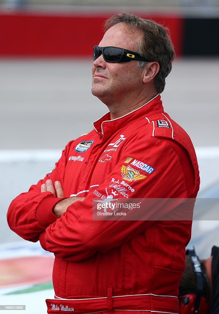 Mike Wallace, driver of the #01 Chevrolet, looks on during qualifying for the NASCAR Nationwide Series VFW Sport Clips Hero 200 at Darlington Raceway on May 10, 2013 in Darlington, South Carolina.