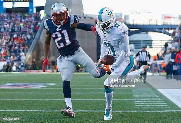 Mike Wallace of the Miami Dolphins catches a touchdown pass as Malcolm Butler of the New England Patriots defends during the second quarter at...