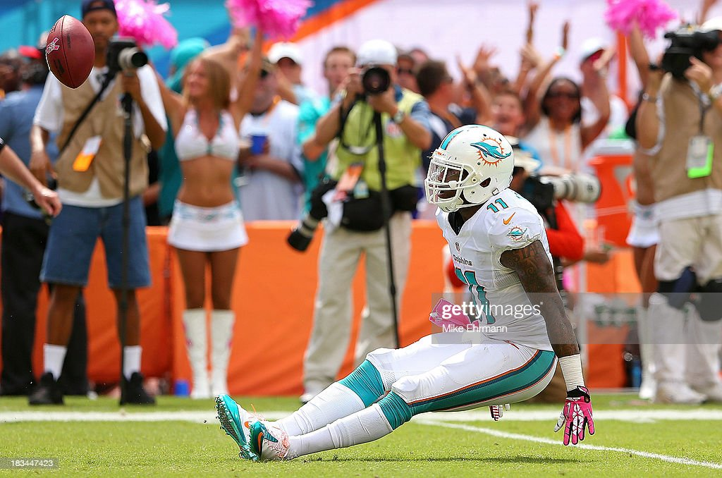 Mike Wallace #11 of the Miami Dolphins reacts to making a catch against the Baltimore Ravens during a game at Sun Life Stadium on October 6, 2013 in Miami Gardens, Florida.