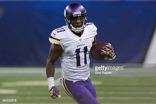 Mike Wallace of the Minnesota Vikings runs the ball in the second quarter while playing the Detroit Lions during an NFL game at Ford Field on October...