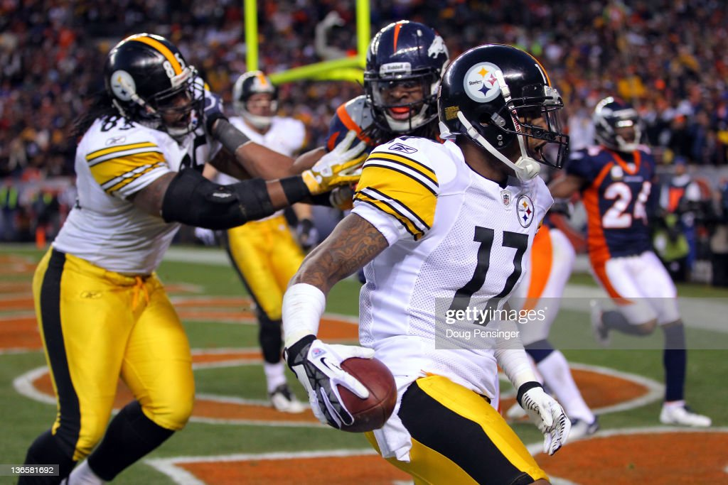 Mike Wallace #17 of the Pittsburgh Steelers runs the ball for a touchdown in the third quarter against the Denver Broncos during the AFC Wild Card Playoff game at Sports Authority Field at Mile High on January 8, 2012 in Denver, Colorado.
