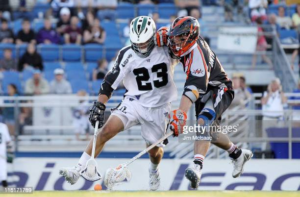 Mike Ward of the Long Island Lizards battles for a loose ball against Kevin Unterstein of the Denver Outlaws during their Major League Lacrosse game...