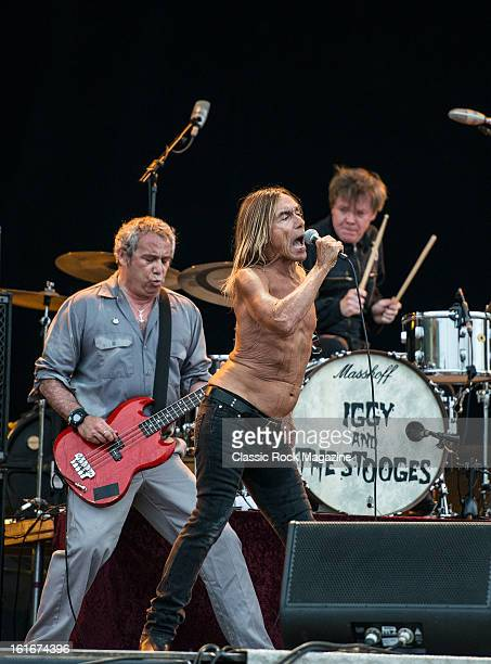 Mike Watt Iggy Pop and Toby Dammit of American rock band Iggy and The Stooges performing live onstage at Hard Rock Calling Festival July 13 2012