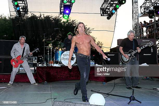 Mike Watt Scott Asheton Iggy Pop and James Williamson of Iggy and the Stooges perform in concert during the Free Press Summer Festival at Eleanor...