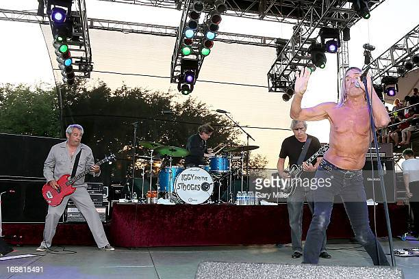 Mike Watt Scott Asheton James Williamson and Iggy Pop of Iggy and the Stooges perform in concert during the Free Press Summer Festival at Eleanor...