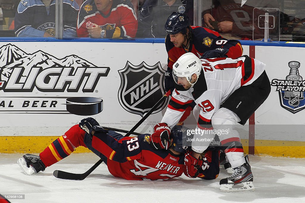 Mike Weaver #43 and Stephen Weiss #9 of the Florida Panthers defend against <a gi-track='captionPersonalityLinkClicked' href=/galleries/search?phrase=Travis+Zajac&family=editorial&specificpeople=864182 ng-click='$event.stopPropagation()'>Travis Zajac</a> #19 of the New Jersey Devils in Game Two of the Eastern Conference Quarterfinals during the 2012 NHL Stanley Cup Playoffs at the BankAtlantic Center on April 15, 2012 in Sunrise, Florida. The Panthers defeated the Devils 4-2.