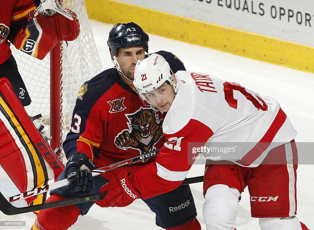 Mike Weaver of the Florida Panthers and Kyle Quincey of the Detroit Red Wings battle next to the net at the BBT Center on December 10 2013 in Sunrise...