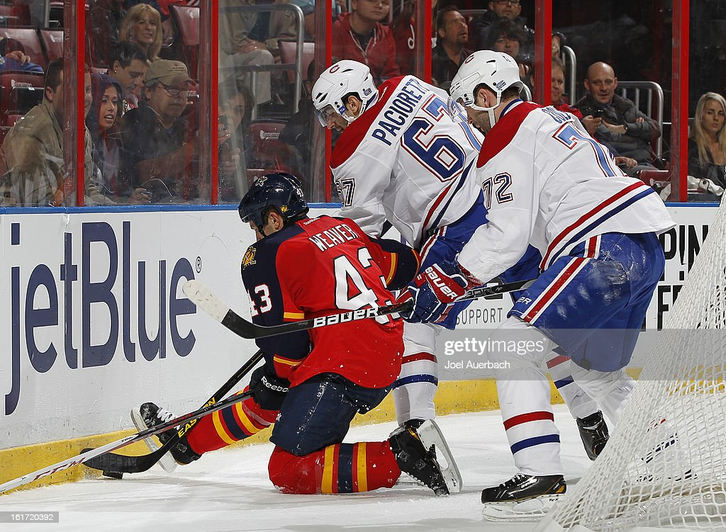 Mike Weaver #43 of the Florida Panthers fights for control of the puck with <a gi-track='captionPersonalityLinkClicked' href=/galleries/search?phrase=Max+Pacioretty&family=editorial&specificpeople=4324972 ng-click='$event.stopPropagation()'>Max Pacioretty</a> #67 and <a gi-track='captionPersonalityLinkClicked' href=/galleries/search?phrase=Erik+Cole&family=editorial&specificpeople=204754 ng-click='$event.stopPropagation()'>Erik Cole</a> #72 of the Montreal Canadiens at the BB&T Center on February 14, 2013 in Sunrise, Florida. The Canadiens defeated the Panthers 1-0 in overtime.