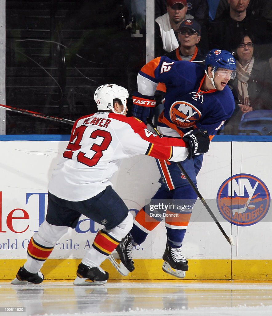 Mike Weaver #43 of the Florida Panthers skates against Josh Bailey #12 of the New York Islanders at the Nassau Veterans Memorial Coliseum on April 16, 2013 in Uniondale, New York. The Islanders defeated the Panthers 5-2.
