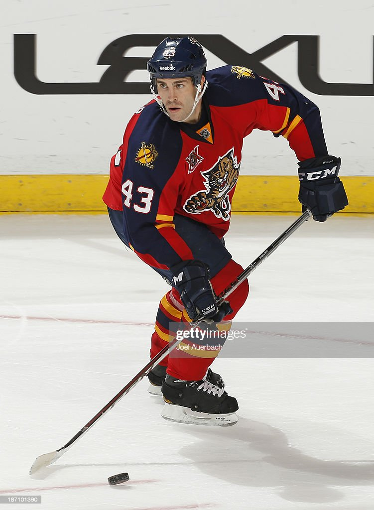 Mike Weaver #43 of the Florida Panthers skates with the puck against the Edmonton Oilers at the BB&T Center on November 5, 2013 in Sunrise, Florida. The Oilers defeated the Panthers 4-3 in overtime.