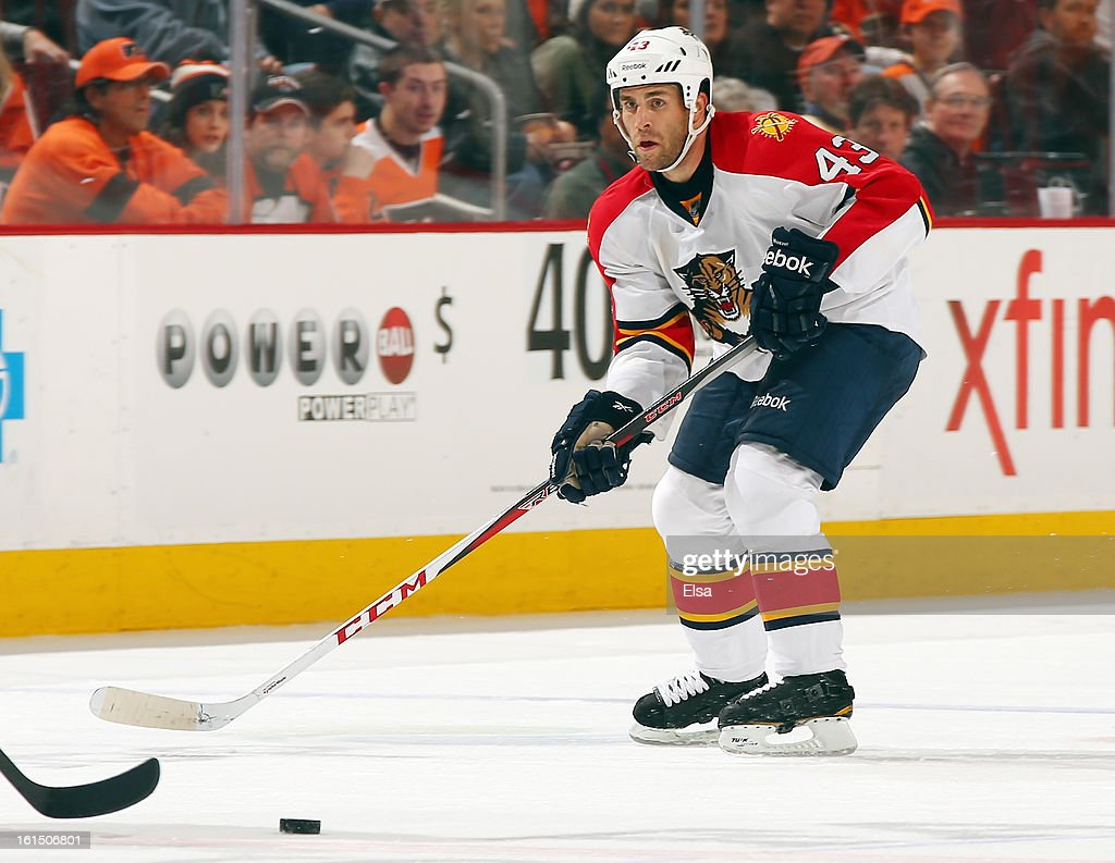 Mike Weaver #43 of the Florida Panthers takes the puck against the Philadelphia Flyers on February 5, 2013 at the Wells Fargo Center in Philadelphia, Pennsylvania. The Florida Panthers defeated the Philadelphia Flyers 3-2 in an overtime shootout.