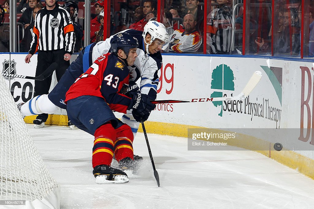 Mike Weaver #43 of the Florida Panthers tangles with Evander Kane #9 of the Winnipeg Jets at the BB&T Center on January 31, 2013 in Sunrise, Florida.