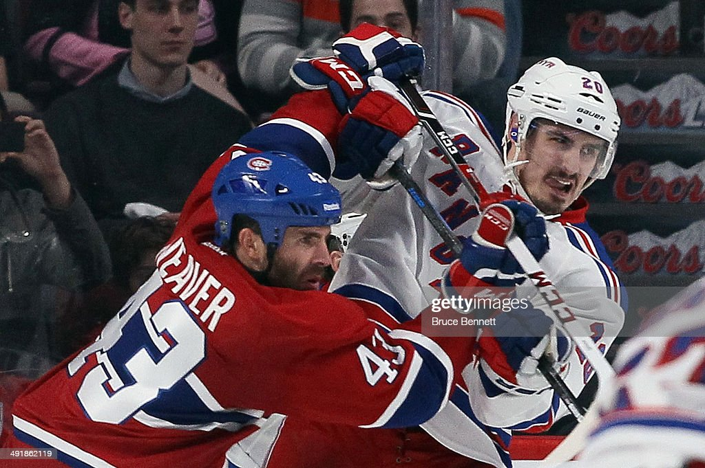 Mike Weaver #43 of the Montreal Canadiens moves <a gi-track='captionPersonalityLinkClicked' href=/galleries/search?phrase=Chris+Kreider&family=editorial&specificpeople=5894671 ng-click='$event.stopPropagation()'>Chris Kreider</a> #20 of the New York Rangers from the crease in Game One of the Eastern Conference Final during the 2014 Stanley Cup Playoffs at the Bell Centre on May 17, 2014 in Montreal, Canada. The Rangers defeated the Canadiens 7-2.