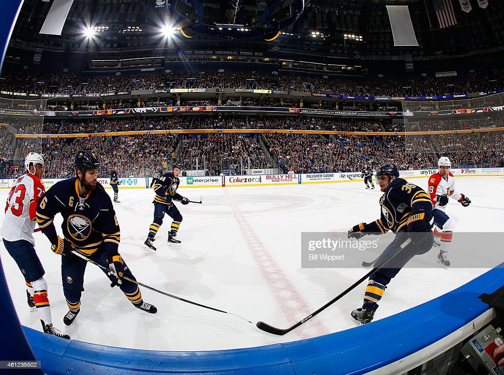 Mike Weber and Patrick Kaleta of the Buffalo Sabres skate against the Florida Panthers on January 2 2015 at the First Niagara Center in Buffalo New...