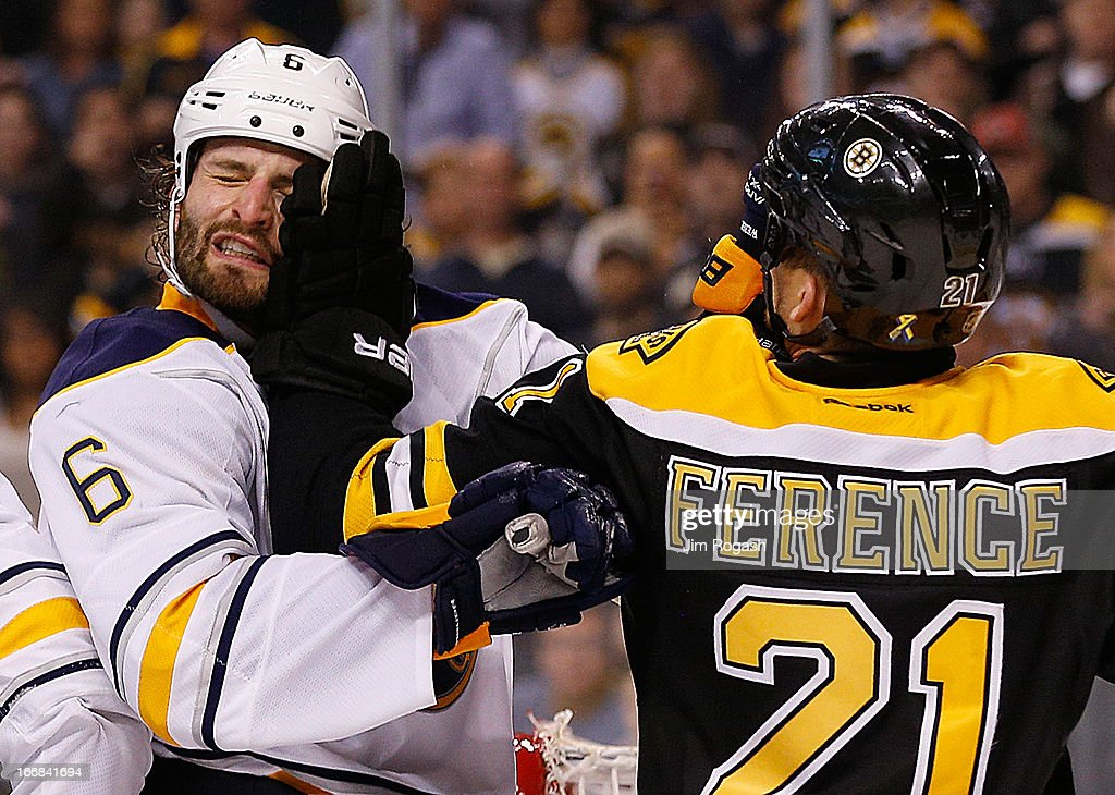 Mike Weber #6 of the Buffalo Sabres and <a gi-track='captionPersonalityLinkClicked' href=/galleries/search?phrase=Andrew+Ference&family=editorial&specificpeople=202264 ng-click='$event.stopPropagation()'>Andrew Ference</a> #21 of the Boston Bruins exchanges shoves during a five-minute overtime at TD Garden on April 17, 2013 in Boston, Massachusetts.