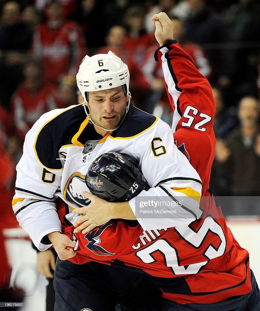 Mike Weber #6 of the Buffalo Sabres and <a gi-track='captionPersonalityLinkClicked' href=/galleries/search?phrase=Jason+Chimera&family=editorial&specificpeople=211264 ng-click='$event.stopPropagation()'>Jason Chimera</a> #25 of the Washington Capitals fight during the first period at Verizon Center on December 30, 2011 in Washington, DC.
