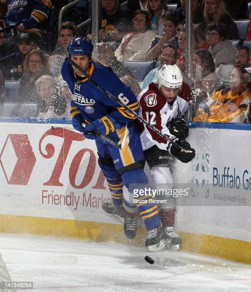 Mike Weber of the Buffalo Sabres backs into Kevin Porter of the Colorado Avalanche at the First Niagara Center on March 14 2012 in Buffalo New York...