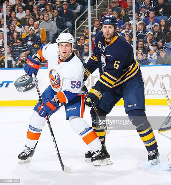 Mike Weber of the Buffalo Sabres battles for position against Michael Haley of the New York Islanders at HSBC Arena on February 13 2011 in Buffalo...