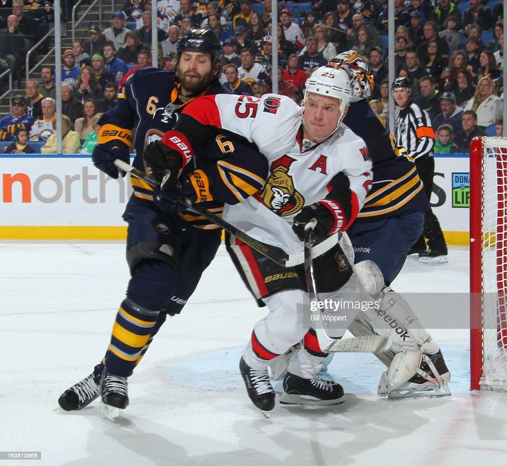 Mike Weber #6 of the Buffalo Sabres battles in front of the net against Chris Neil #25 of the Ottawa Senators on March 16, 2013 at the First Niagara Center in Buffalo, New York.