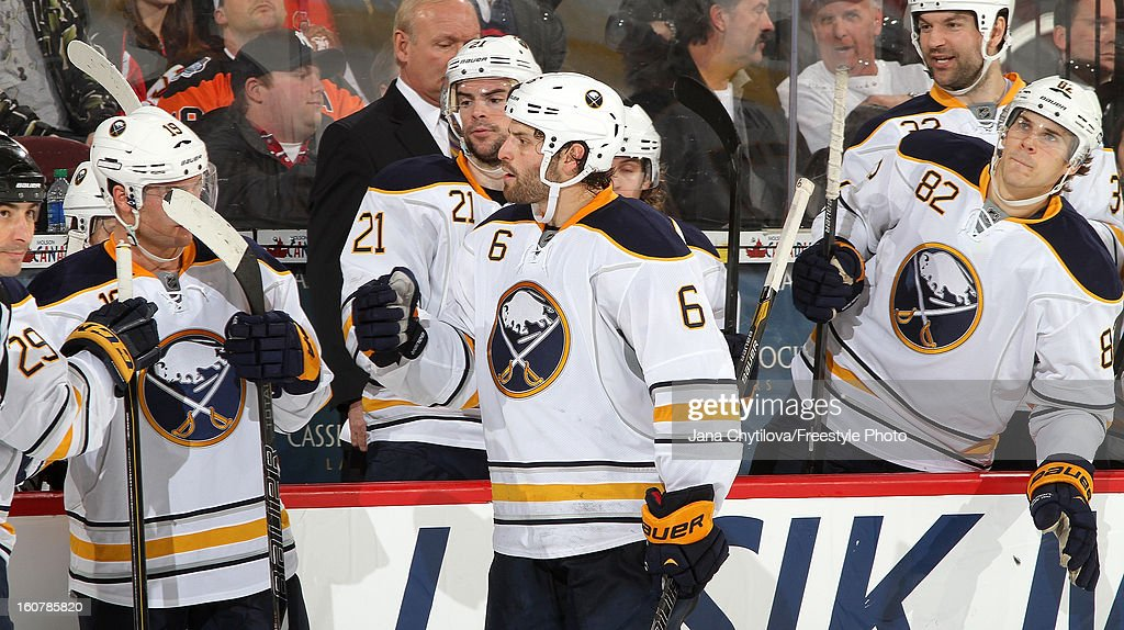 Mike Weber #6 of the Buffalo Sabres celebrates a third period goal with teammates <a gi-track='captionPersonalityLinkClicked' href=/galleries/search?phrase=Drew+Stafford&family=editorial&specificpeople=220617 ng-click='$event.stopPropagation()'>Drew Stafford</a> #21 and Marcus Foligno #82 during an NHL game against the Ottawa Senators at Scotiabank Place on February 5, 2013 in Ottawa, Ontario, Canada.