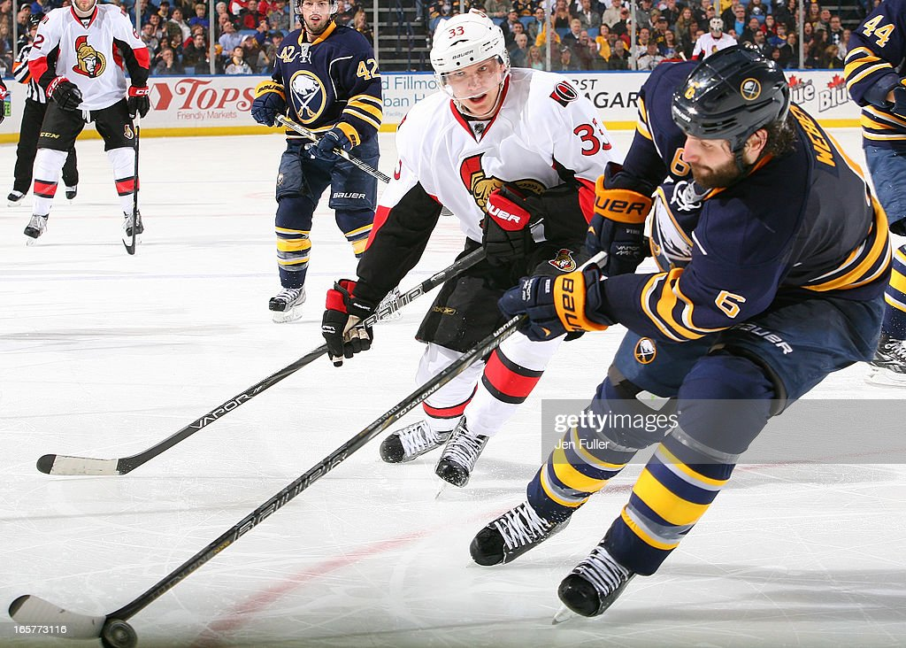 Mike Weber #6 of the Buffalo Sabres controls the puck in front of <a gi-track='captionPersonalityLinkClicked' href=/galleries/search?phrase=Jakob+Silfverberg&family=editorial&specificpeople=5894639 ng-click='$event.stopPropagation()'>Jakob Silfverberg</a> #33 of the Ottawa Senators on April 05, 2013 at the First Niagara Center in Buffalo, New York.