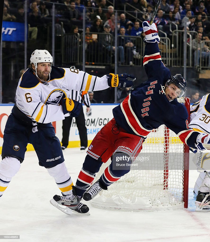 Mike Weber #6 of the Buffalo Sabres hits <a gi-track='captionPersonalityLinkClicked' href=/galleries/search?phrase=Darroll+Powe&family=editorial&specificpeople=4527845 ng-click='$event.stopPropagation()'>Darroll Powe</a> #8 of the New York Rangers during the second period at Madison Square Garden on March 3, 2013 in New York City.