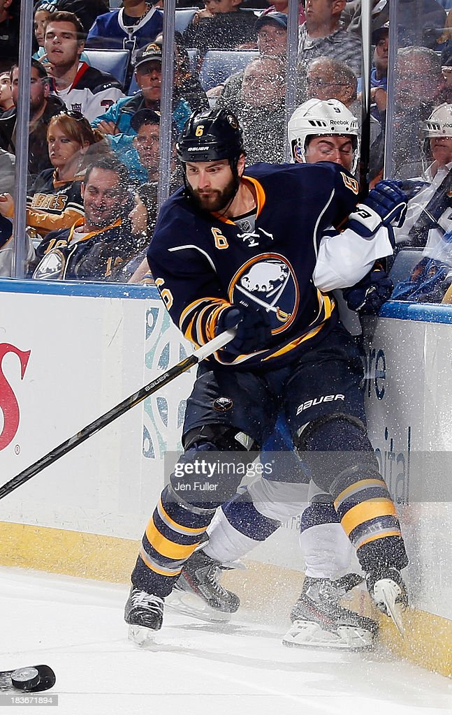 Mike Weber #6 of the Buffalo Sabres keeps an eye on the puck as he checks <a gi-track='captionPersonalityLinkClicked' href=/galleries/search?phrase=Tyler+Johnson+-+Ice+Hockey+Player&family=editorial&specificpeople=14574766 ng-click='$event.stopPropagation()'>Tyler Johnson</a> #9 of the Tampa Bay Lightning at First Niagara Center on October 8, 2013 in Buffalo, New York. Tampa defeated Buffalo 3-2.
