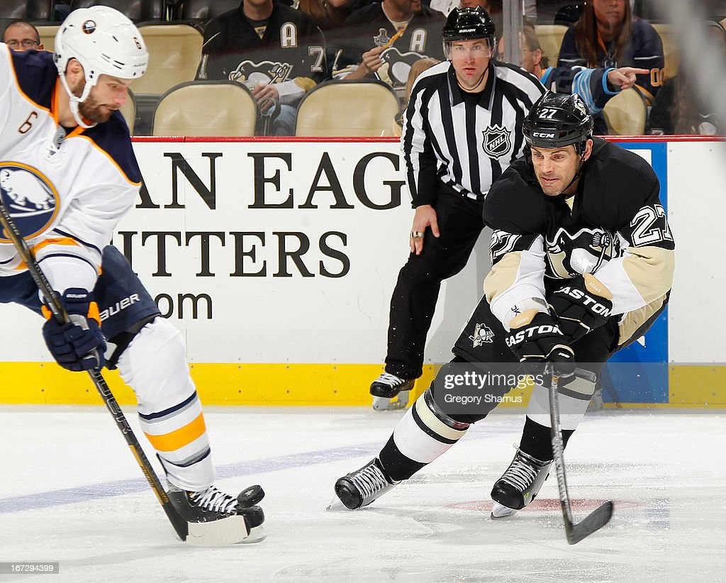 Mike Weber #6 of the Buffalo Sabres moves the puck in front of <a gi-track='captionPersonalityLinkClicked' href=/galleries/search?phrase=Craig+Adams&family=editorial&specificpeople=211144 ng-click='$event.stopPropagation()'>Craig Adams</a> #27 of the Pittsburgh Penguins on April 23, 2013 at Consol Energy Center in Pittsburgh, Pennsylvania. Buffalo won the game 4-2.