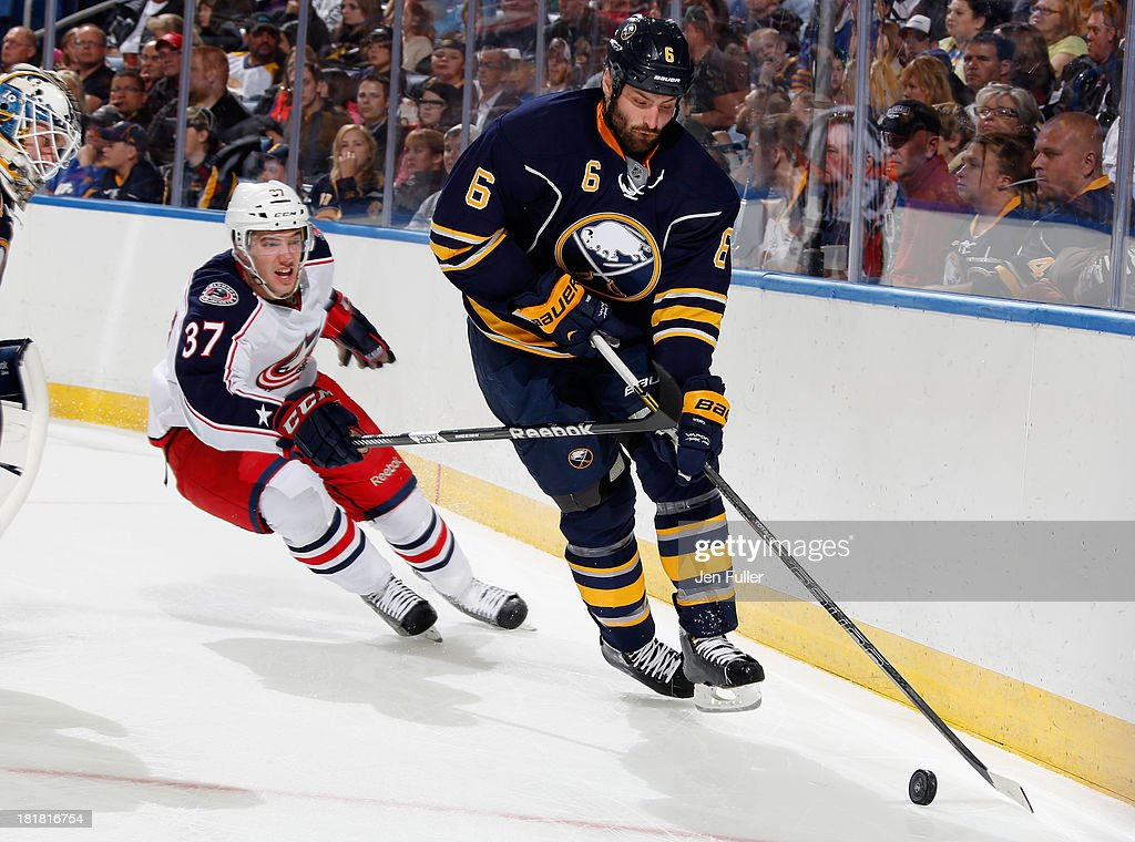 Mike Weber #6 of the Buffalo Sabres skates with the puck alongside Dalton Smith #37 of the Columbus Blue Jackets during a preseason game at First Niagara Center on September 25, 2013 in Buffalo, New York.