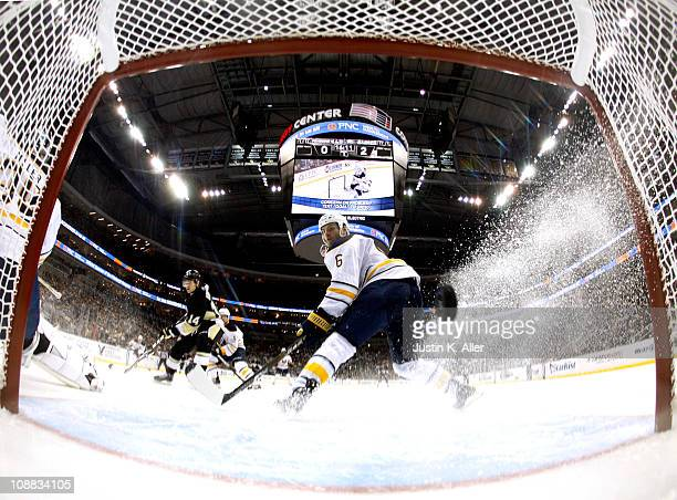 Mike Weber of the Buffalo Sabres watches a shot by Tyler Kennedy of the Pittsburgh Penguins go in the net at Consol Energy Center on February 4 2011...