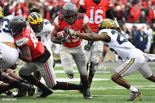 Mike Weber of the Ohio State Buckeyes rushes the ball against the Michigan Wolverines at Ohio Stadium on November 26 2016 in Columbus Ohio
