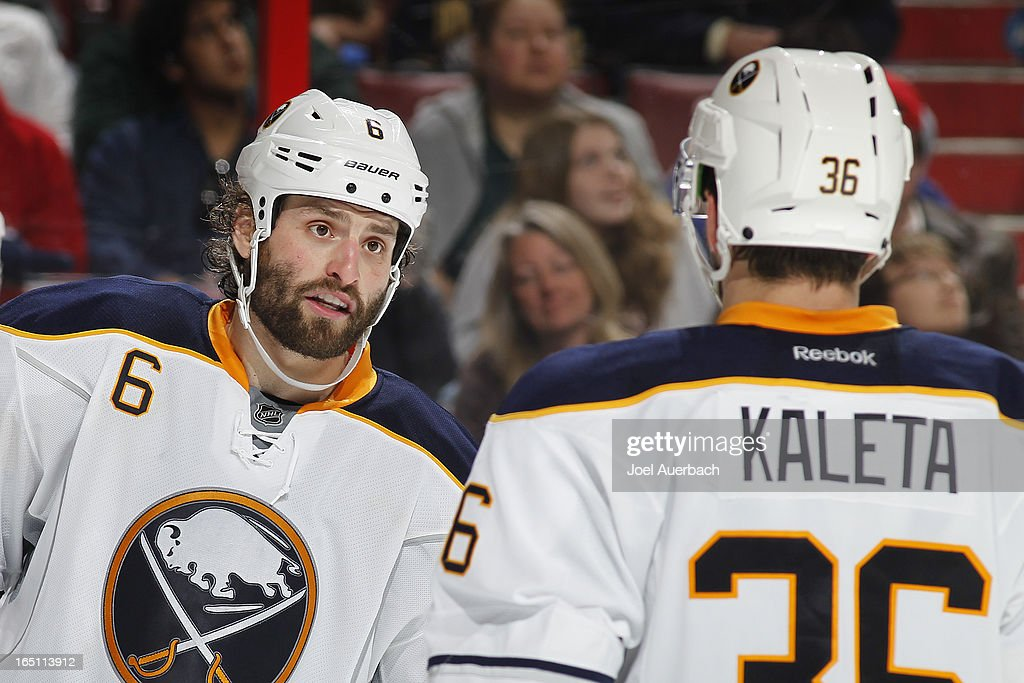 Mike Weber talks to Patrick Kaleta of the Buffalo Sabres during a break in action against the Florida Panthers at the BBT Center on March 28 2013 in...