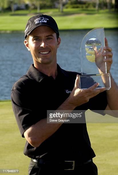Mike Weir celebrates on the 18th hole after a twostroke win