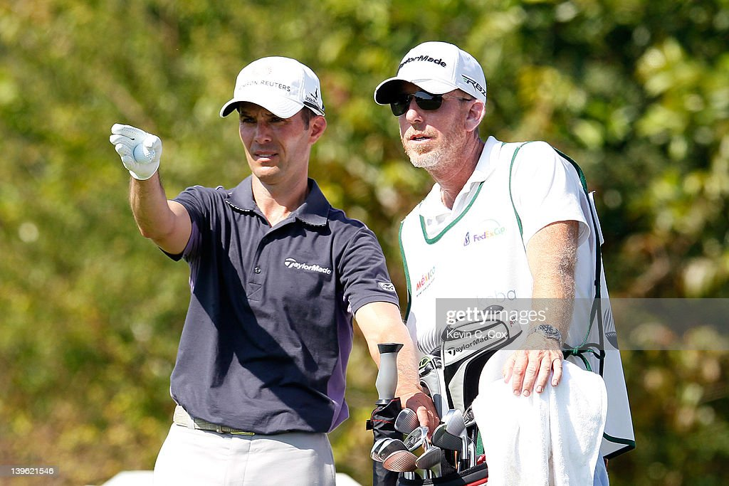 <a gi-track='captionPersonalityLinkClicked' href=/galleries/search?phrase=Mike+Weir&family=editorial&specificpeople=182540 ng-click='$event.stopPropagation()'>Mike Weir</a> of Canada converses with his caddie before teeing off the 10th hole during the first round of the Mayakoba Golf Classic at Riviera Maya-Cancún held at El Camaleon Golf Club at Mayakoba on February 23, 2012 in Playa del Carmen, Mexico.