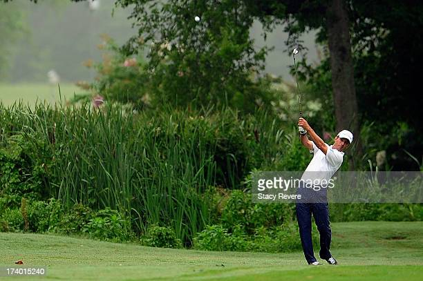 Mike Weir of Canada hits his second shot on the ninth hole during a continuation of the first round of the Sanderson Farms Championship at Annandale...