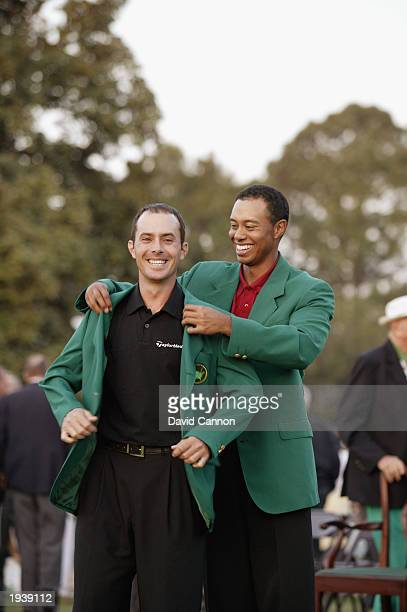Mike Weir of Canada is presented with the green jacket after winning the play off after the final round of the 2003 Masters Tournament at the Augusta...