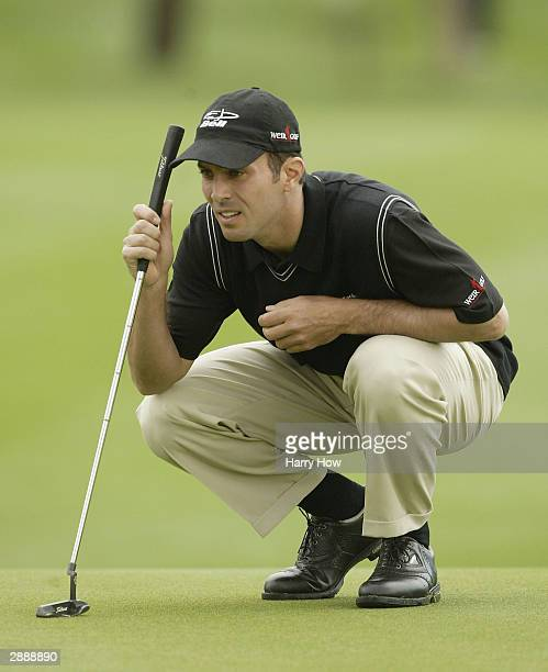 Mike Weir of Canada lines up a putt on the 11th hole during the first round of the Bob Hope Chrysler Classic at Bermuda Dunes Country Club on January...