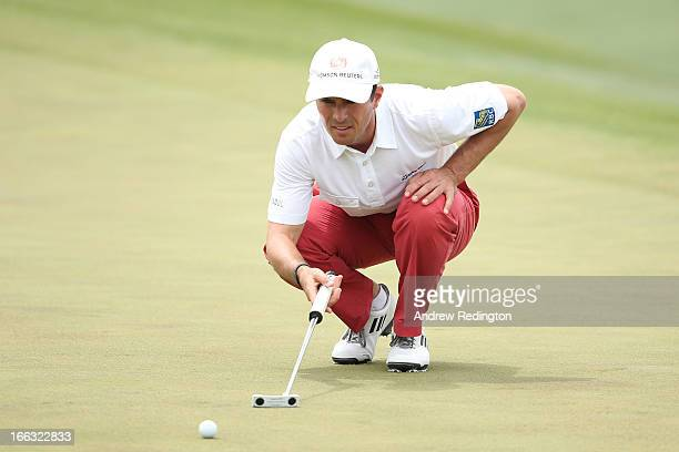 Mike Weir of Canada lines up a putt on the 18th hole during the first round of the 2013 Masters Tournament at Augusta National Golf Club on April 11...
