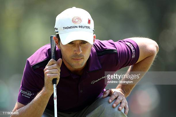 Mike Weir of Canada lines up a putt on the first green during the second round of the 2011 Masters Tournament at Augusta National Golf Club on April...