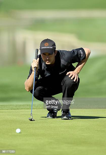 Mike Weir of Canada lines up a putt on the seventh hole during the final round of the Bob Hope Classic at the Palmer Private Course at PGA West on...