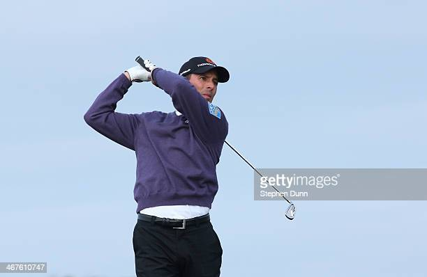 Mike Weir of Canada plays a shot during the first round of the ATT Pebble Beach National ProAm at Monterey Peninsula Country Club on February 6 2014...