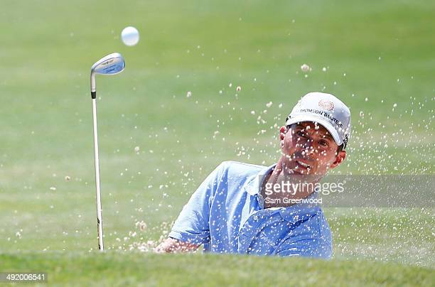 Mike Weir of Canada plays a shot from the bunker on the ninth hole during the final round of the HP Byron Nelson Championship at the TPC Four Seasons...