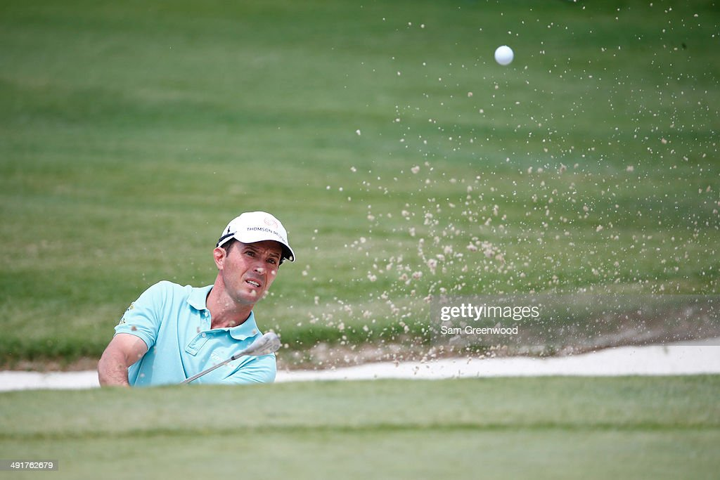 Mike Weir of Canada plays a shot out of the bunker on the second hole during the third round of the HP Byron Nelson Championship at the TPC Four...