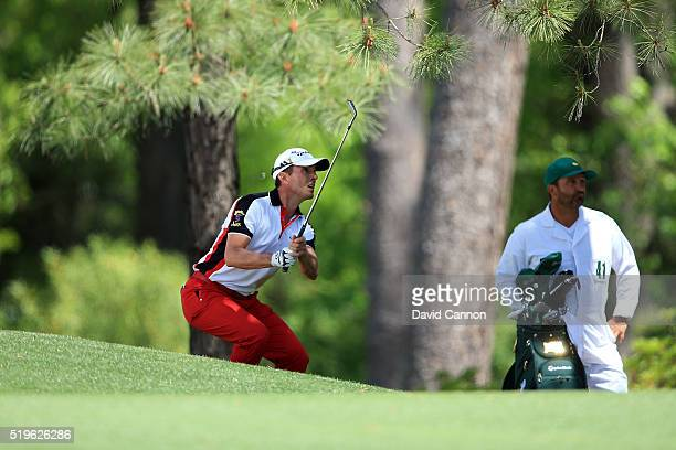 Mike Weir of Canada plays his third shot on the fifth hole as caddie Danny Sahl looks on during the first round of the 2016 Masters Tournament at...