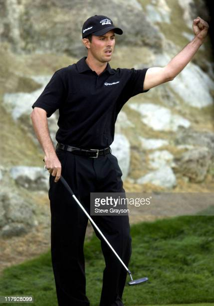 Mike Weir of Canada reacts after sinking a birdie putt on the 17th hole