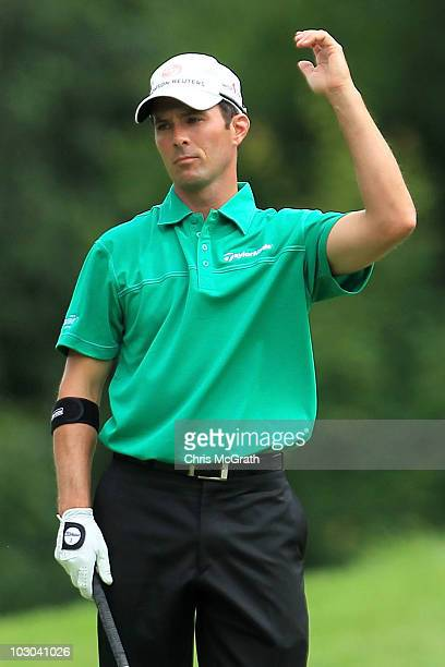 Mike Weir of Canada reacts to his second shot on the 12th hole during round one of the 2010 RBC Canadian Open at St George's Golf and Country Club on...