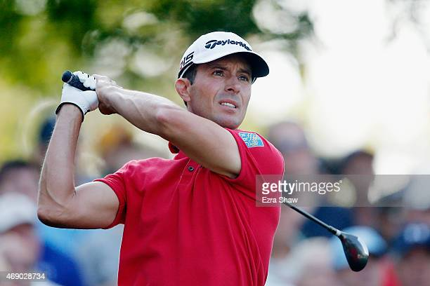 Mike Weir of Canada watches his tee shot on the fourth hole during the first round of the 2015 Masters Tournament at Augusta National Golf Club on...